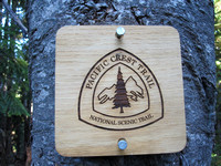 PCT signs mark the trail
